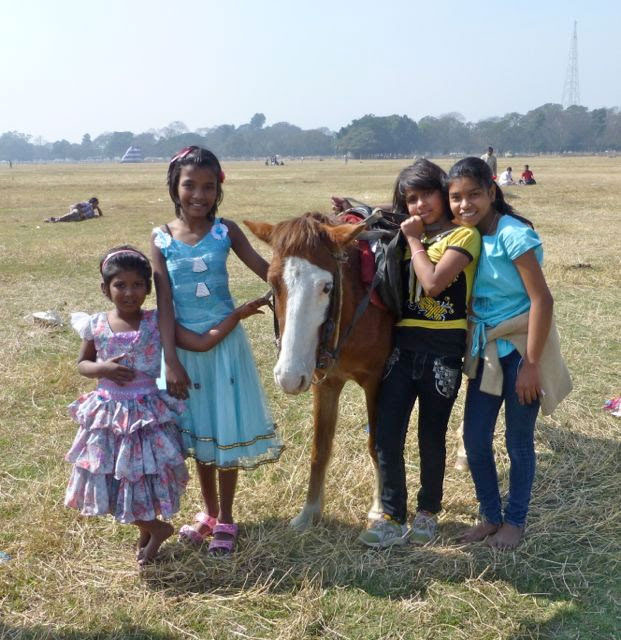 Girls with horse in Calcutta
