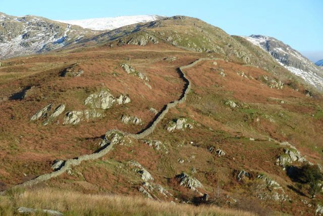Cumbrian-mountains-with-age-old-walls-Over-the-nex